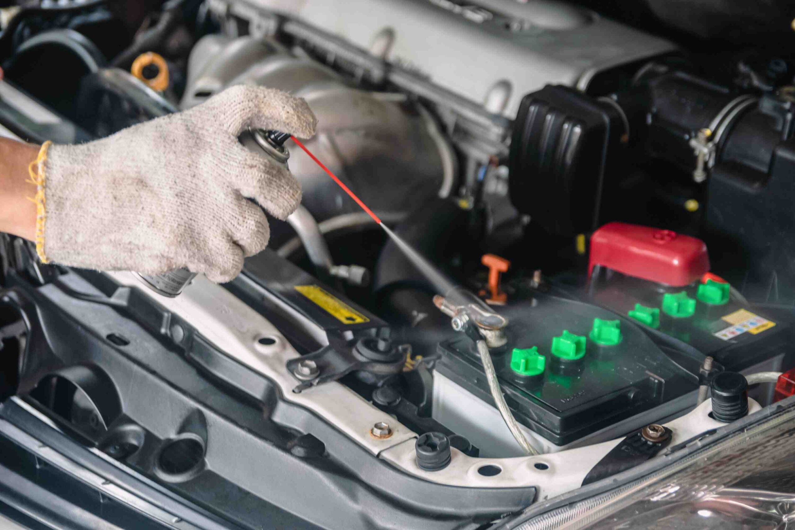 Cleaning car battery with spray