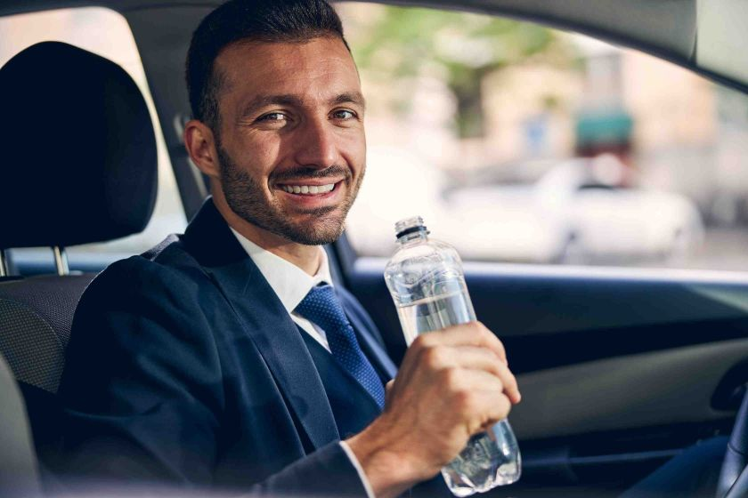 Drinking water in car