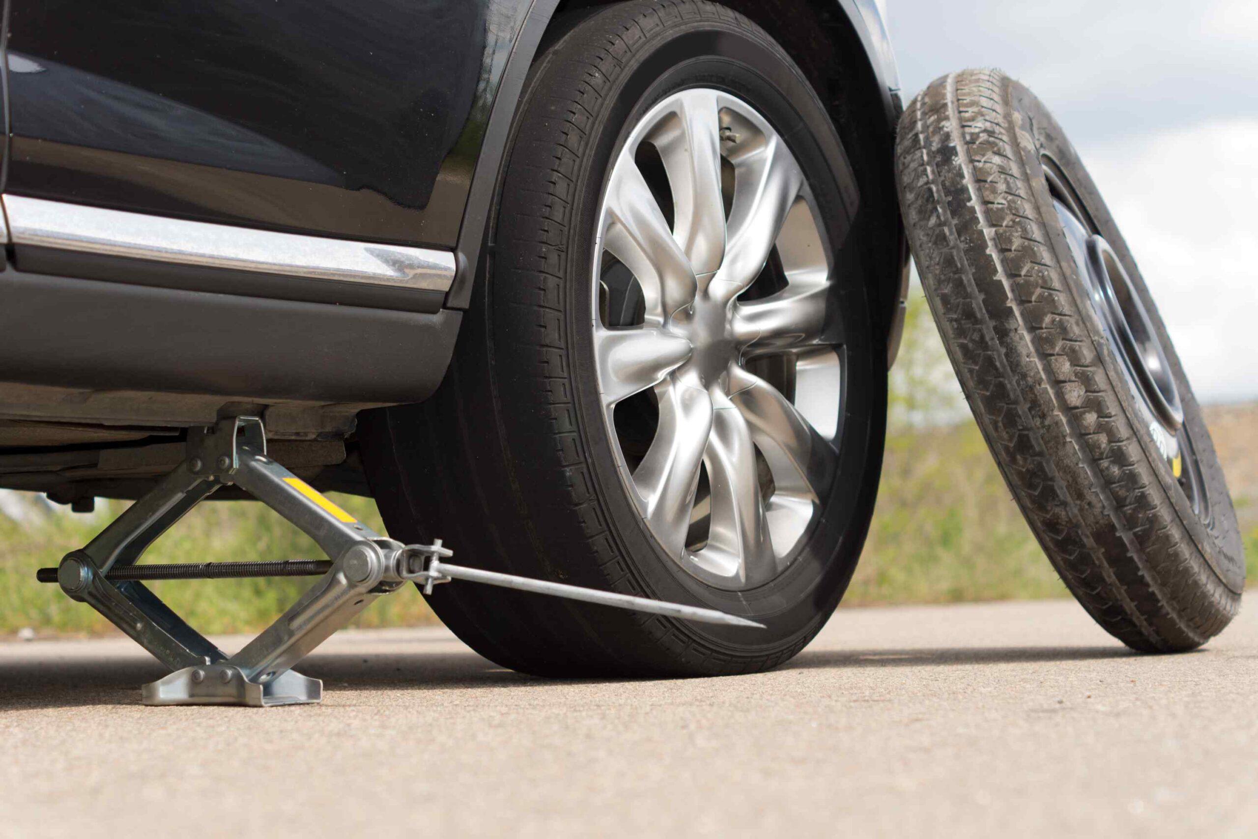 change flat car tire - tire jack